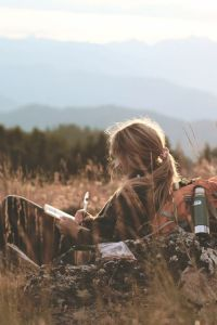 girl writing nature